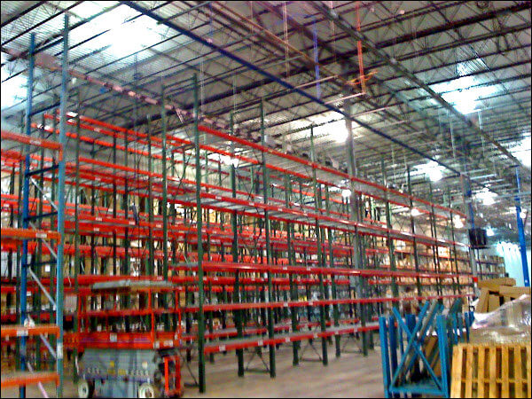 Pallet Rack System Installation in Progress for Improved Efficiencies in a Warehouse Environment